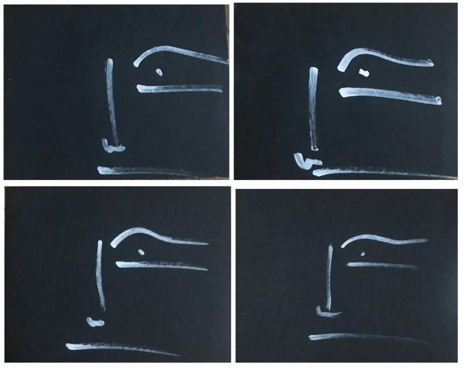 alt text: Four drawings of the same but slightly altered face on black paper with white ink, each made with five lines and one dot.