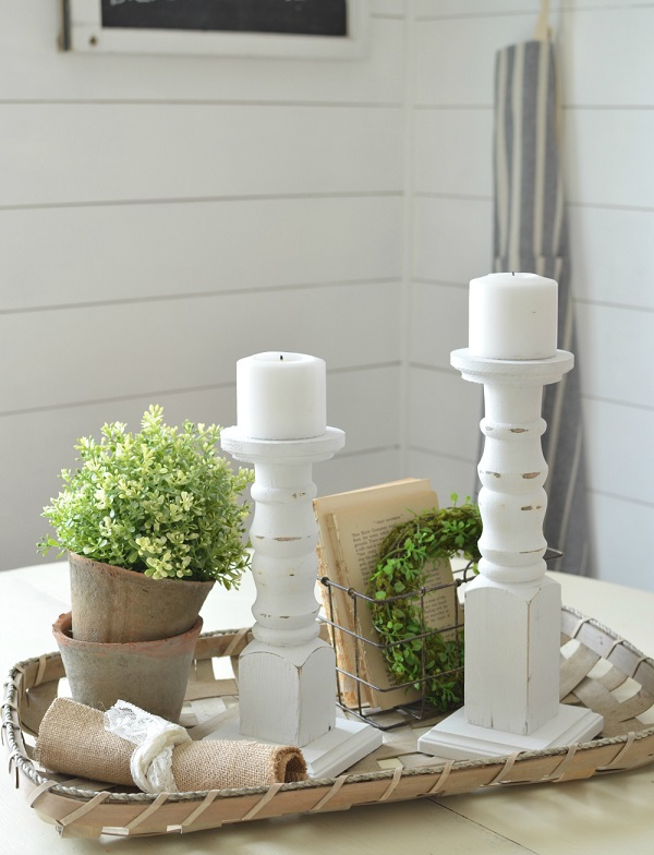 DIY FARMHOUSE CANDLESTICKS. Elegant farmhouse decorations. Farmhouse decor ideas to inspire your wedding. DIY Farmhouse decor ideas for the home that can be used for inspiration to plan your wedding. DIY Rustic wedding decor ideas that you can steal from farmhouse decorations to inspire your style. Farmhouse modern decor ideas to use for your wedding inspiration #modernhomedecor #farmhousedecor #rusticwedding #decorideas