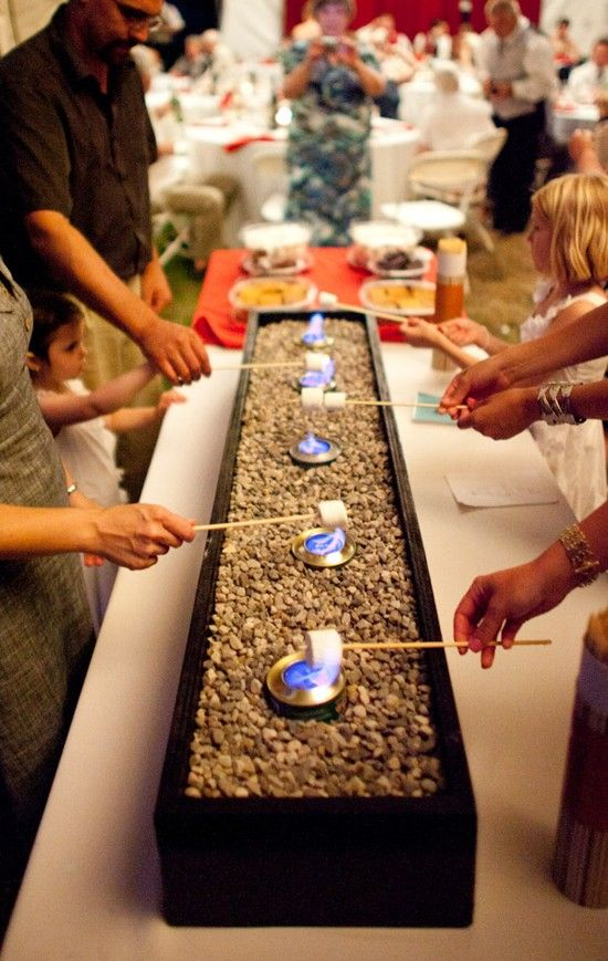 S'more bar for your wedding. Here is a list of creative wedding bar ideas you can use to set up your wedding. Wedding decoration ideas that will wow your wedding guests. Here is a list of the best food reception stations you can set up to entertain your wedding guests. Unique Wedding station ideas for your reception. #Weddingstation #weddingbarideas #weddingideas