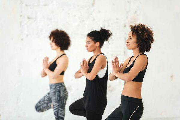 Group of young women doing yoga exercises