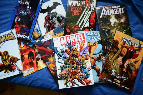 Photo showing multiple Marvel an D.C. comic book series.