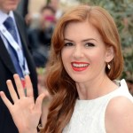 Isla Fisher wears a white dress at the Cannes Film Festival
