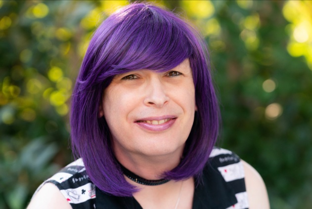Portrait of woman with purple hair.