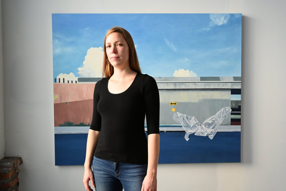 Christine Rasmussen stands in front of her painting Wayward Spirit (Ave 20), Oil on Canvas