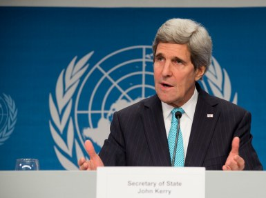 Kerry at press conference expressing opinions.