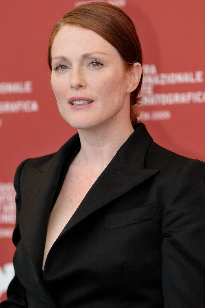 Julianne Moore at a festival event, she is wearing a black blazer, posing for a picture.