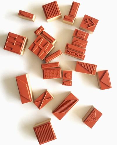 Stampville. De rubberen stempels zijn gebaseerd op stedelijke-grafische picto's.
