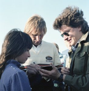 Derek Bell autographing a polaroid of himself just taken by mate Gordon. Confused? Derek was!