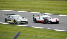 Porsche LPM Team Porsche 919 Hybrid passing Aston Martin Racing Aston Martin Vantage