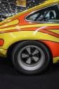 ST bulging rear wheel arches and fat Fuchs wheels