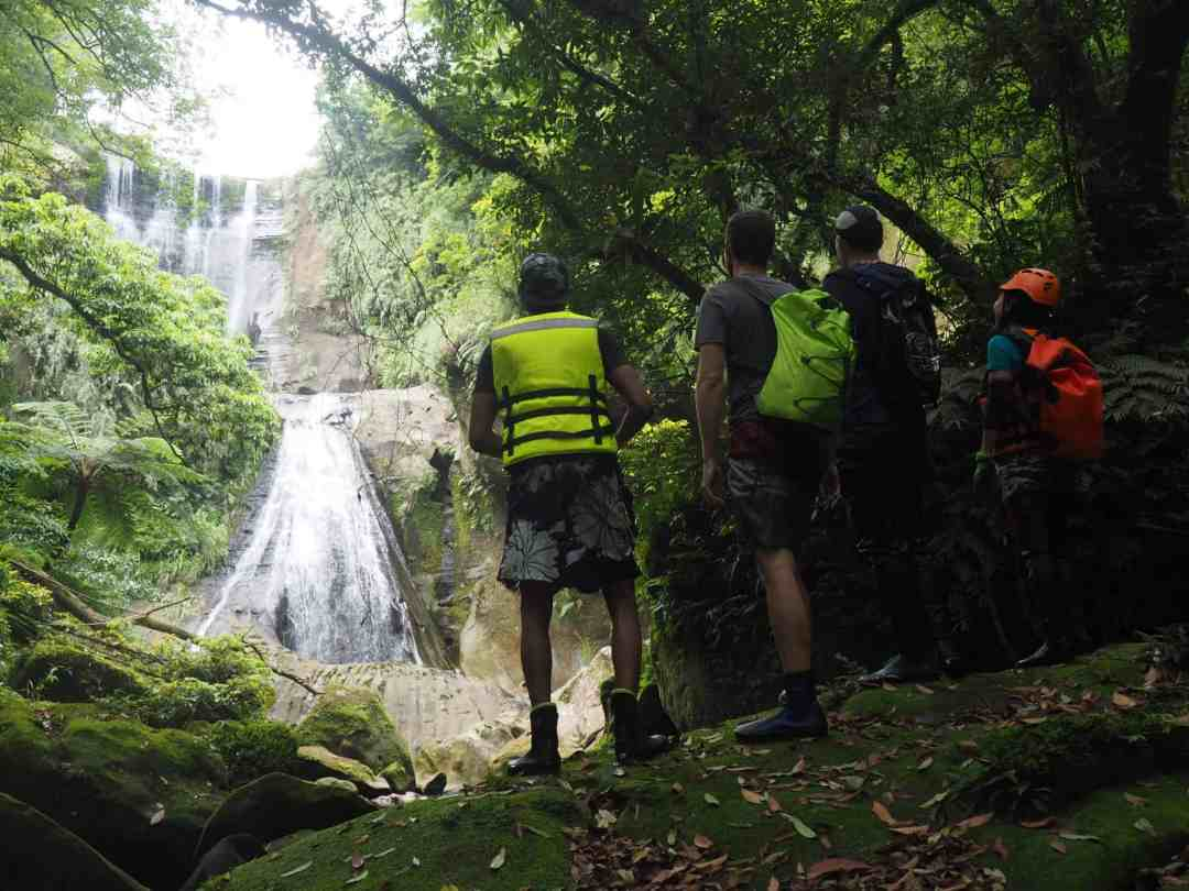 Looking at a waterfall after a river trace.