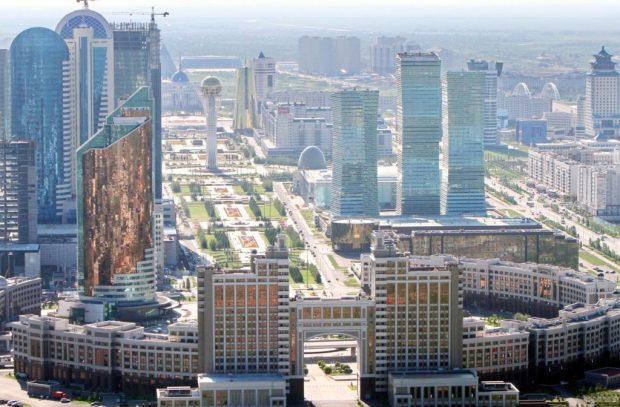 """An aerial view of the city of Astana, taken on July 28, 2011. Kazakh capital formerly known as Akmola, until 1998, Tselinograd until 1992 and Akmolinsk until 1961 is the capital and second largest city (after Almaty) of Kazakhstan, with an officially estimated population of 708,794 as of 1 August 2010. After Kazakhstan gained its independence in 1991, the city and the region were renamed """"Akmola"""", literally meaning """"White Shrine"""". In 1995, the city was designated as the future capital of the newly-independent country, and the capital was officially moved from Almaty on December 10, 1997. AFP PHOTO/ STANISLAV FILIPPOV"""