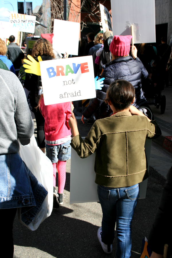 Protest signs at the women march DTLA Los Angeles by cupcake punk