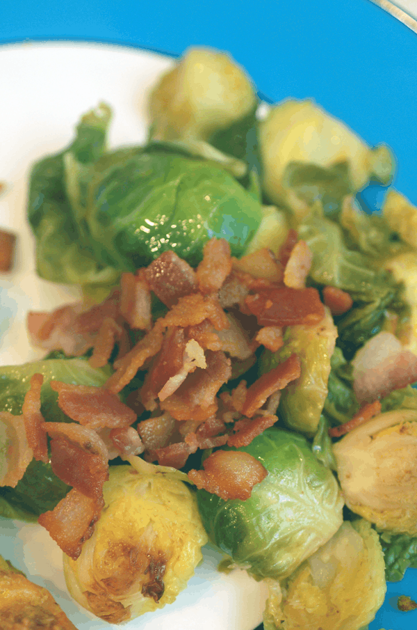 bacon on top of apple juice braised brussel sprouts