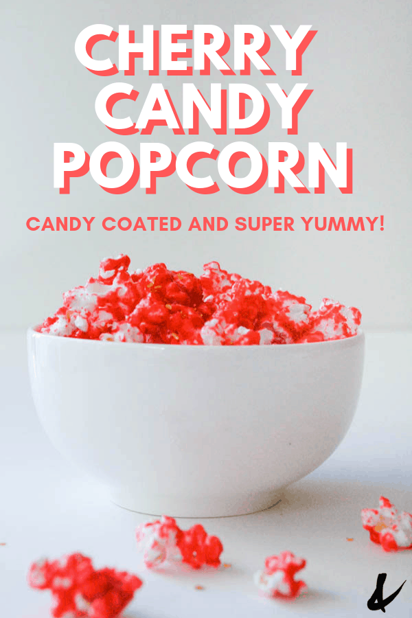 crunchy cherry candy popcorn recipe in a bowl with a text overlay