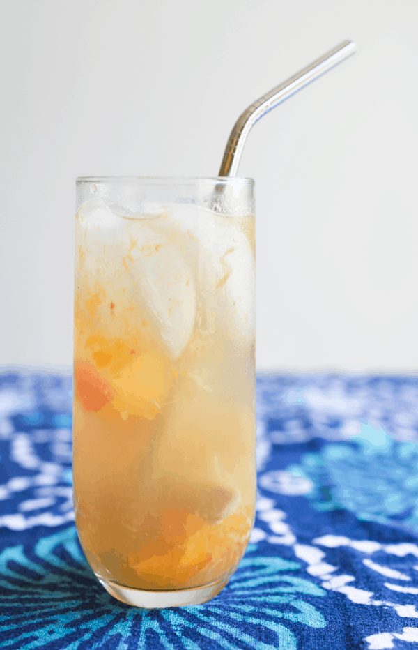 Delicious champagne cocktail with fresh ginger and peach. // www.cupcakesandcutlery.com