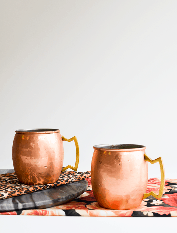 Copper mugs are a great way to serve a Strawberry Mule