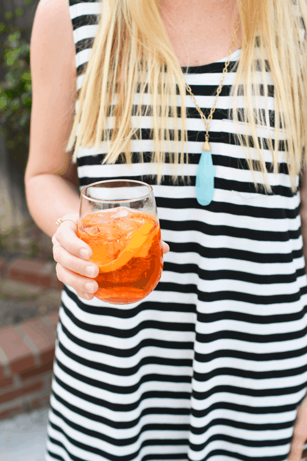 A fave, refreshing summer cocktail recipe, an Aperol Spritz.