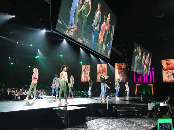 Women on a catwalk during a fashion show for Cabi Clothing.