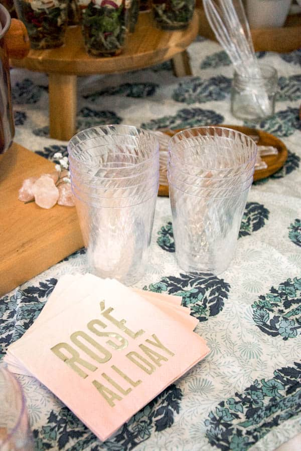 Napkins that say rosé all day on a table