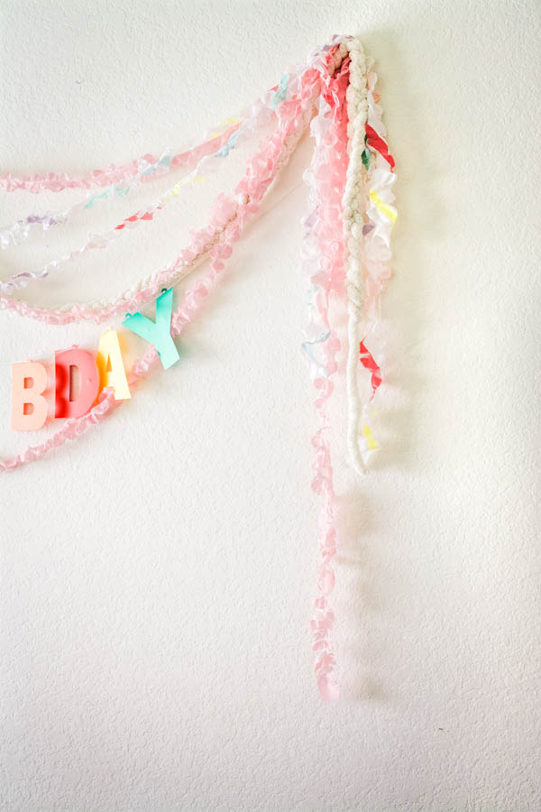 plastic streamers on a wall for party decorations