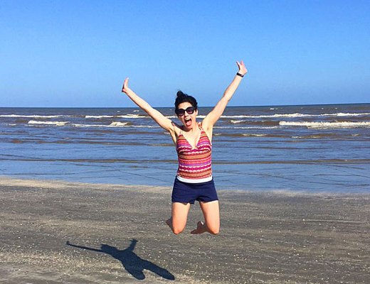 Jumping for Joy at Galveston Beach | www.cupcakesandthecosmos.com
