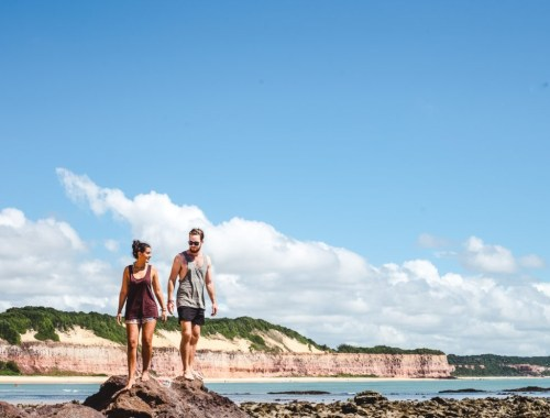 Travel couple in Pipa, Brazil praia dos golfinhos