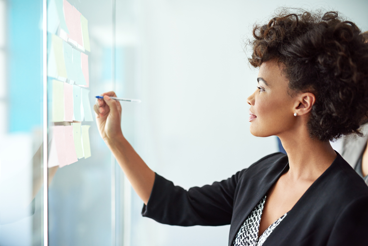 Woman making content strategy notes