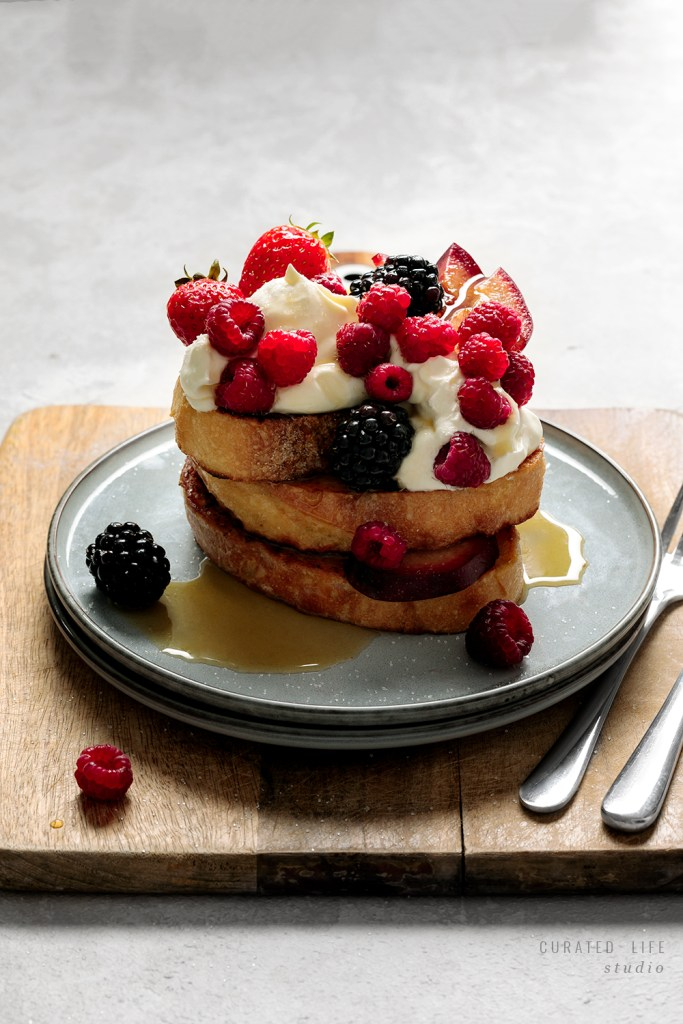 A simple recipe on how to make Homemade French Toast, served with summer berries & sticky maple syrup.   #French #toast #easy #recipe #best #topping #sweet #curatedlifestudio