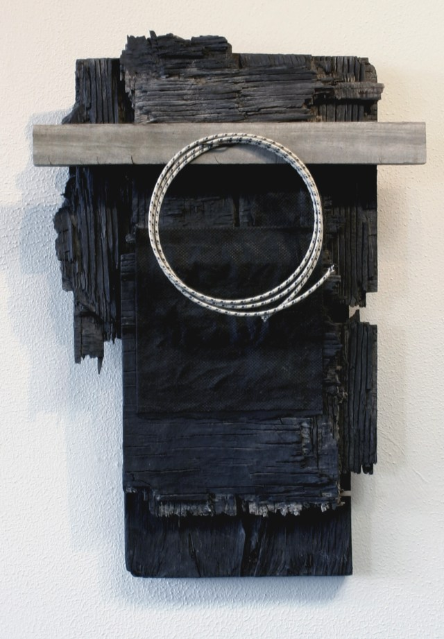 """""""Wound-up Wire""""  found object construction  17.5"""" x 11.5"""" x 2.75""""   (wood, fiber-coated wire, paper, cloth,   rusted industrial staple and water-based paint)"""