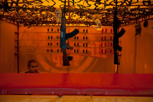 Fairground worker with machine guns, Ukraine, 2012