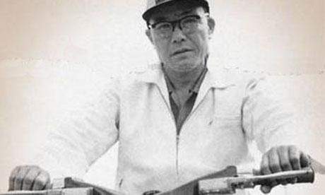 Soichiro Honda on one of his early motorbikes