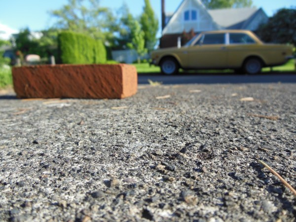 Volvo 142 and brick