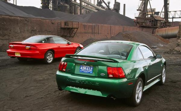 1999-chevrolet-camaro-z28-and-ford-mustang-gt-coupes-photo-345211-s-986x603