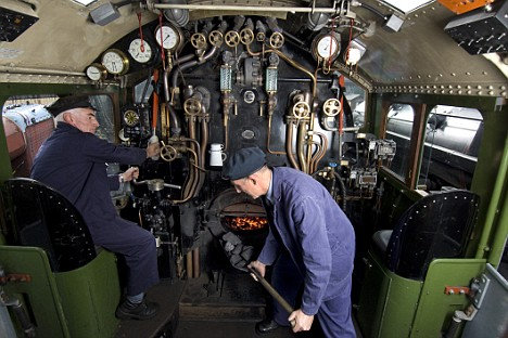 "Inside the cab of Britain's newest locomotive as it undergoes speed and brake trials this week. 60163 Tornado is the first main line steam engine to be built in 50 years and is hauling test trains with loads of more than 500 tons at 60mph ""effortlessly"". Here driver Cliff Perry and fireman Peter Buckley are putting it through its paces on the Great Central Railway between Loughborough and Leicester. Tomorrow (Thurs 16 Oct 08) the building of Tornado is the subject of a TV documentary ""Absolutely Chuffed: The Men Who Built A Steam Engine"" on BBC4 at 8pm. The project, to construct a Peppercorn class A1 Pacific steam loco from scratch took 18 years and 3 million, all raised by donations. Please credit: Roger Bamber/Guardian News & Media Ltd 2008."