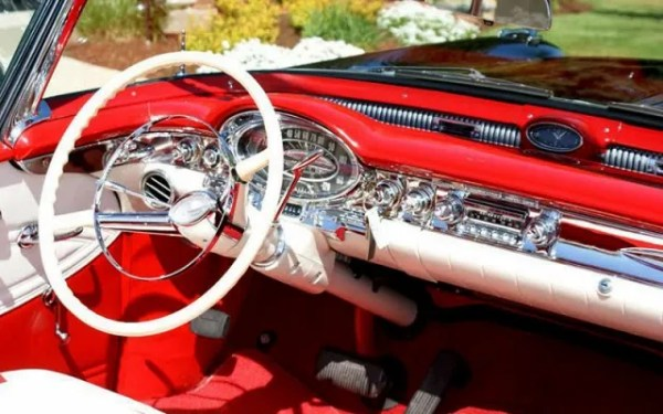 1957 Oldsmobile dashboard valley of dust and debris return (photo of convertible to get the right angle).