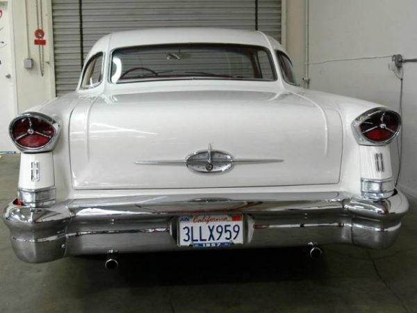 1957 Oldsmobile three piece rear window.