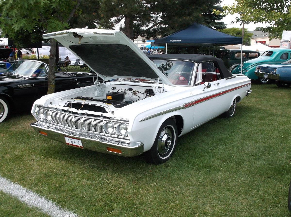 In a desirable combination of white and red this 1964 fury convertible stands like an elegant stone arch between the outlandishness of exner s 1962 and 63