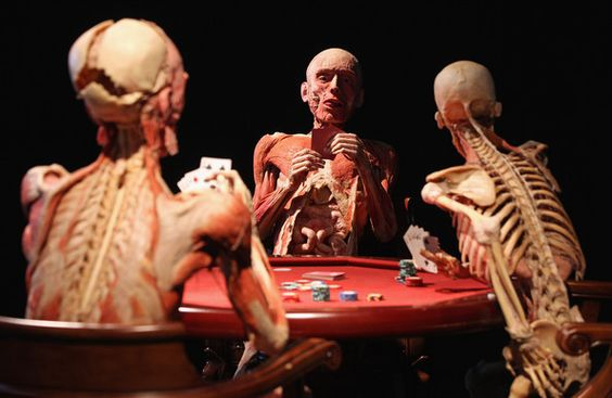 plastinated poker players