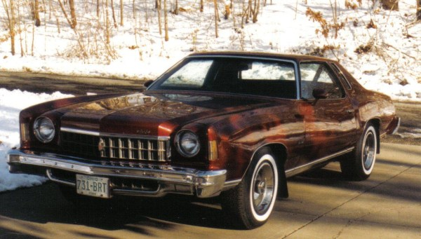 Front three-quarter view of red Chevrolet Monte Carlo