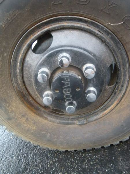 "1955 F-350 Ford, 4x4 Fabco Conversion, Close up of Axle Hub, with ""Fabco"" logo prominent on the endcap"