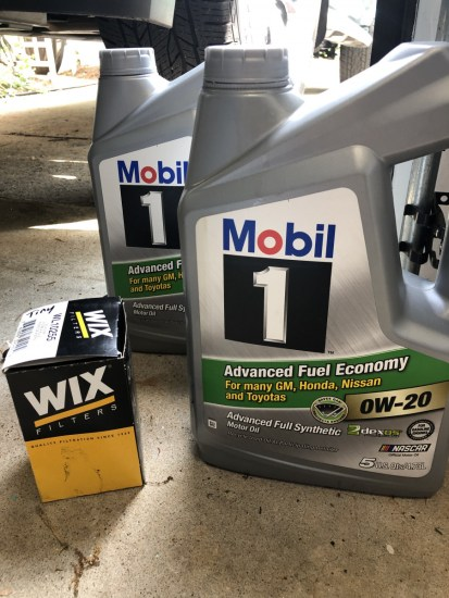 Jugs of Mobil 1 oil and a Wix filter