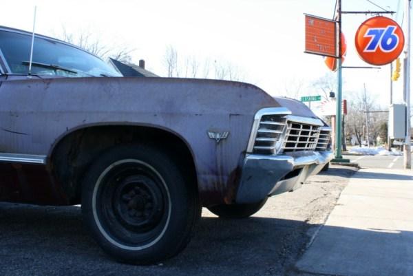 1967 Chevrolet Impala hardtop sedan, Union 76 sign.