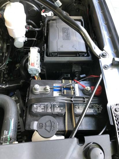Battery under a hood