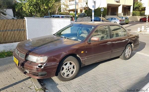 Maroon Nissan Maxima
