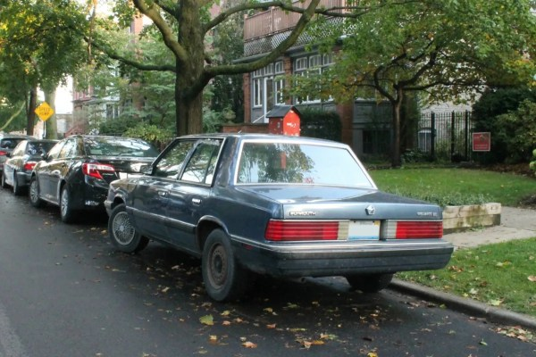 1988 Plymouth Reliant America LE. Edgewater, Chicago, Illinois. Thursday, October 22, 2020.
