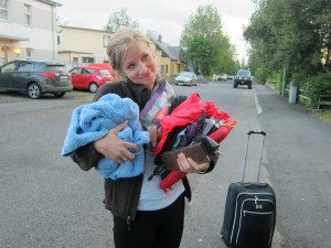 Carrying some of my things into a guesthouse because I was tired of carrying a suitcase. Pack light so this isn't you!