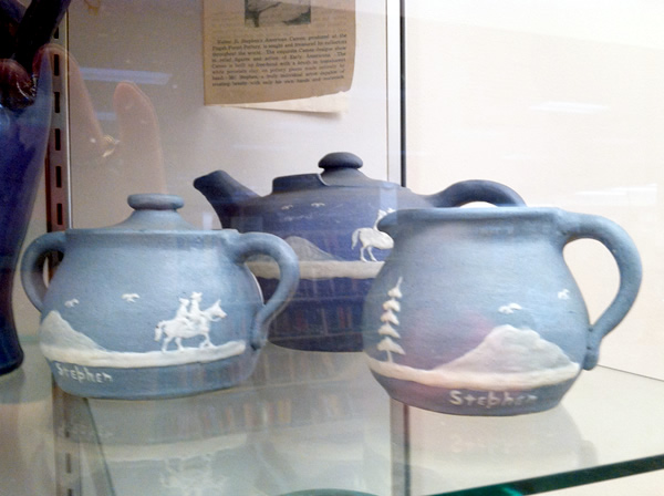 Tea Pot, Creamer and Sugar Bowl from Pisgah Forest Pottery glazed in blue with horsemen, mountains and pine tree scenes