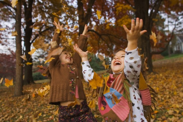 Little Girls Playing in the Leaves