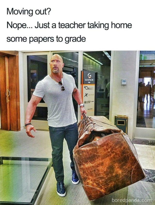 teacher checking paper